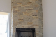 Dry-stack veneer with sandstone hearth