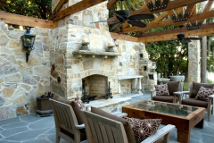 Quartzite stone fireplace and walls in daylight