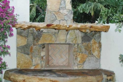 Outdoor fireplace with cypress mantle