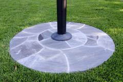 Mortared stone flagpole base