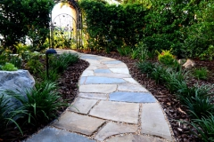 Flagstone path to backyard gate