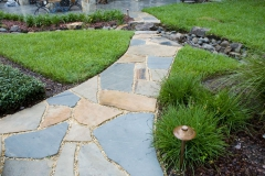 Stone path with boulder step in dry-creek bed