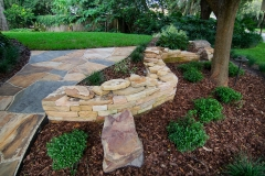 Dry-Stack Retaining Wall with Path to Side Yard